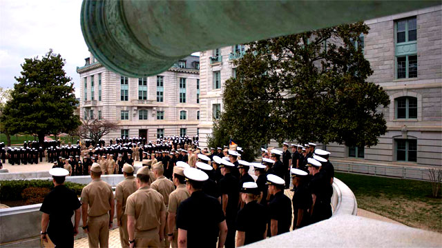 The entire Brigade of Midshipmen stand in formation outside Bancroft Hall for the noon uniform inspection. (Photo by Rachel Boehm)